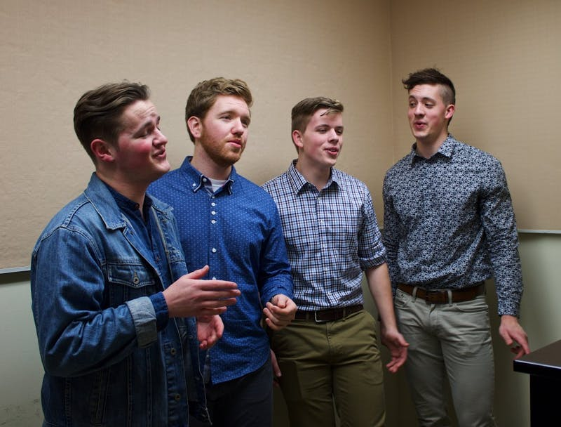 (Left to right) Jesse Persing, Kevin White, Kevin Hendersen, and Brad Henderse​​n practice in the basement of Mago Hunt. The Bluff Boys, UP's only barbershop quartet, is an elite group of singing hobbyists that love to share their passion for music with the community.