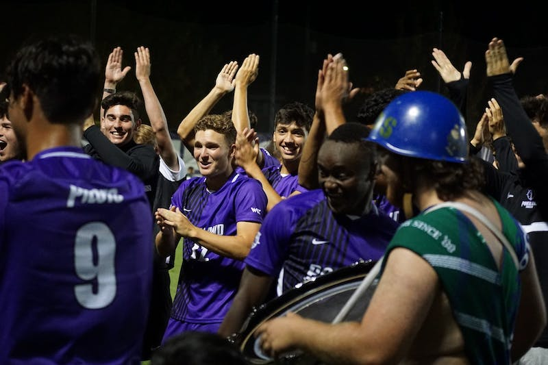 Pilots celebrate with the Villa Drum Squad after their win against Corban.