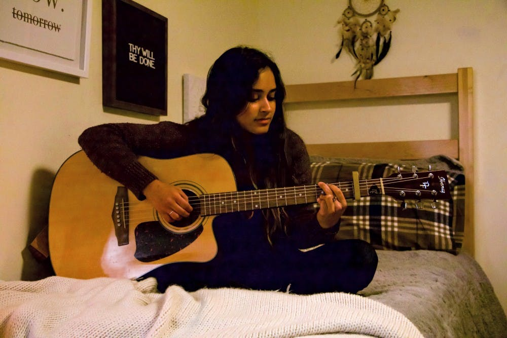 Sophomore Kaitlyn Fernandez plays the guitar and also writes her own music.  She was originally inspired by Taylor Swift but has found a new sound since coming to Portland.