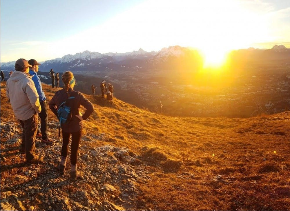 Students from the Salzburg program watch the sunset at the top of Gaisberg mountain in Austria. Photo submitted by junior theater major Clare Kessi.