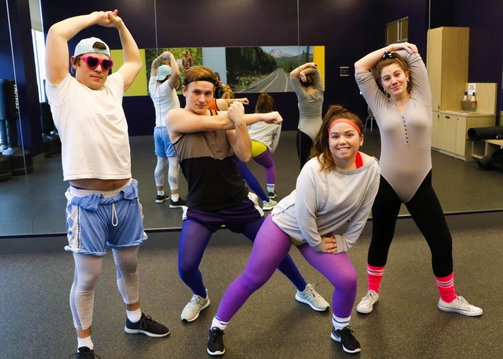 Dance of the Decades is back with a 90's workout theme and a new location — The Pure Space in downtown Portland. Showing off their workout wear and striking power poses (from left to right) are sophomores Quinn Anderson, Morgen Dempsey, CT Mayne and Emma Finney.
