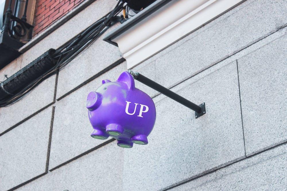 precarious-up-piggy-bank