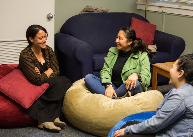 Diana Salgado Huicochea laughs with her mentor Irene Routte in the Moreau Center.