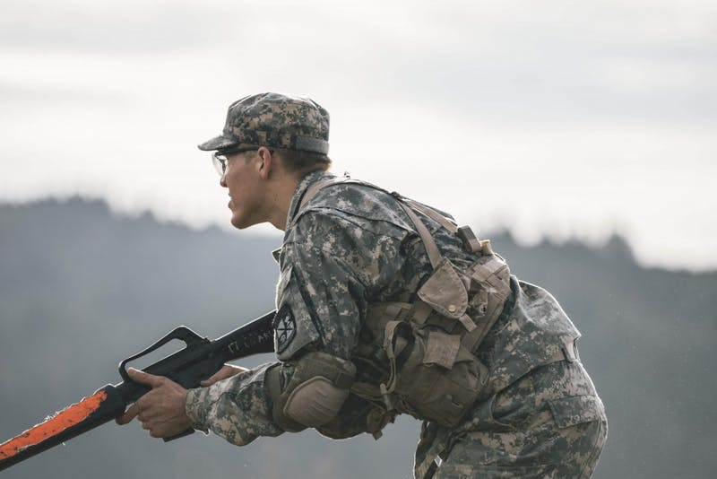 Cadet William Weber advances on the enemy through the dense brush of Franz Campus during Reaction Training.
