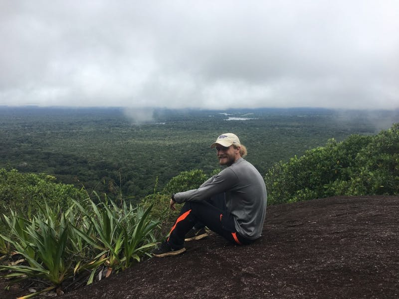 Senior David Gloyd smiles at the top of the Caño Sangre hike in Vaupés, Colombia.  Photo submitted by Gloyd.