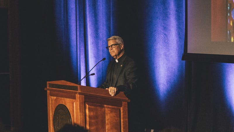 Fr. Mark Poorman announced Thursday that he will be vacating his position after the conclusion of the academic year. Photo from the Presidential Convocation, 2019.