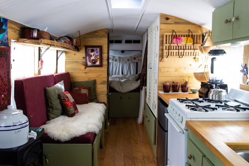 The interior of the bus is simple. It features a window seat, kitchenette, toilet and shower and a bed. While compact, Ruby uses the space effectively, with lots of storage under furniture and hidden in the walls.