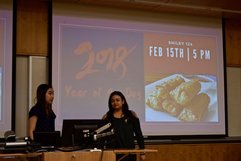 President Jenny Chu and Vice President Andrea Delin kick off International Club's Lunar New Years celebration with a quick presentation on this day's history.