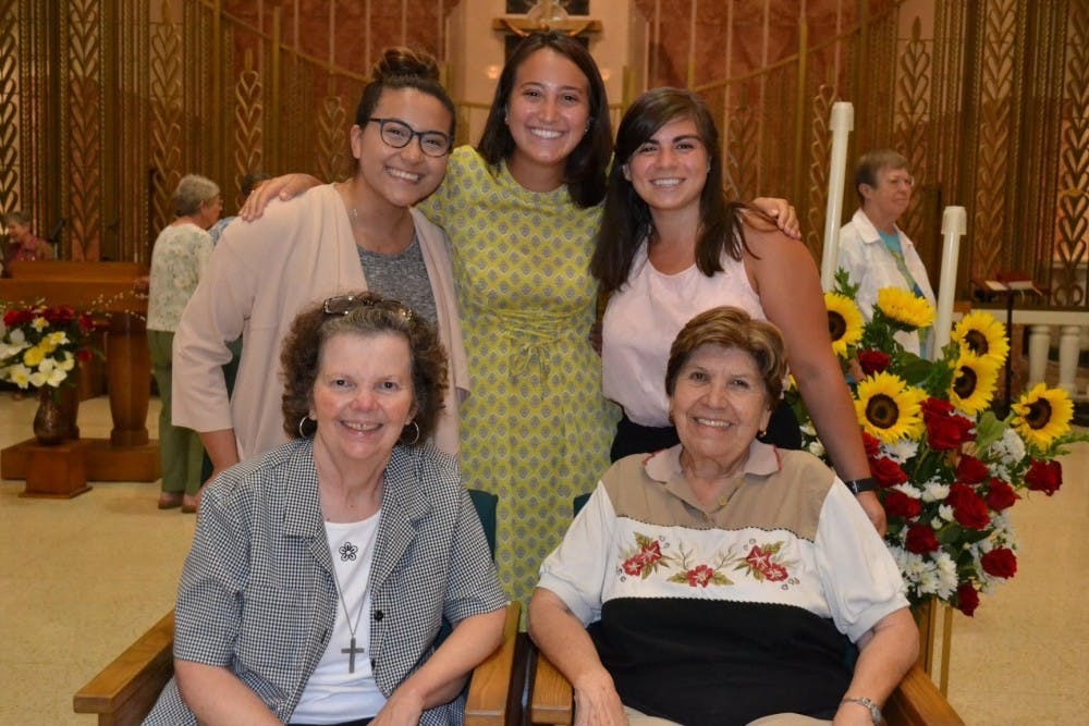 Junior Amanda Hernandez Michalski poses with some of the people she lived in community with during her internship. She lived with the Sisters of St. Joseph in the Medaille House of Discernment. Photo courtesy of Michalski.