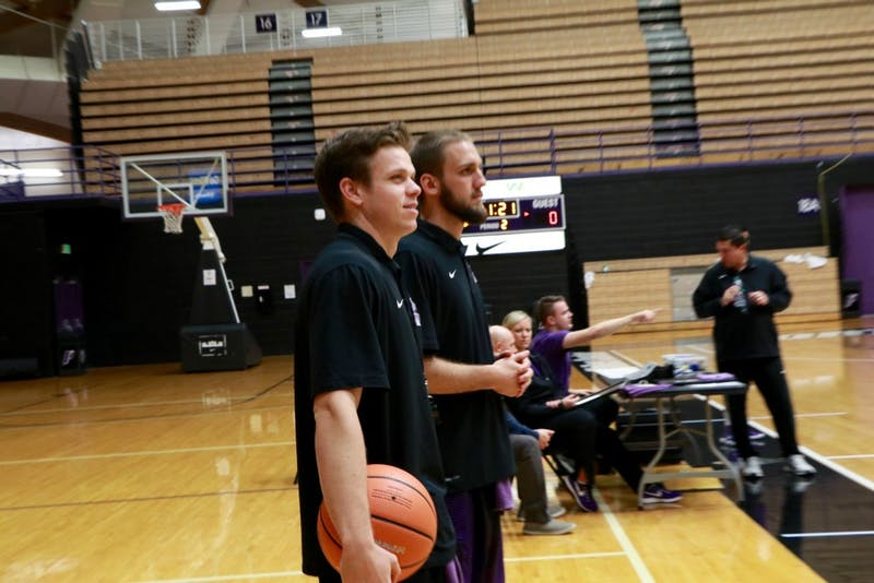 Basketball managers Sam Harris and Dane Swanson watch practice.