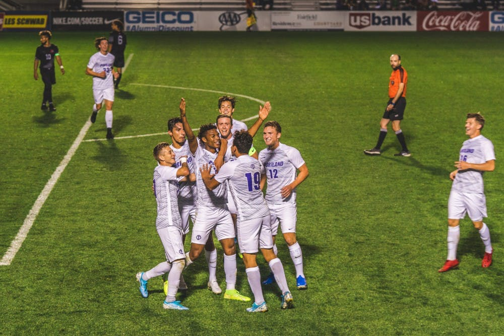 The team celebrates after a goal.
