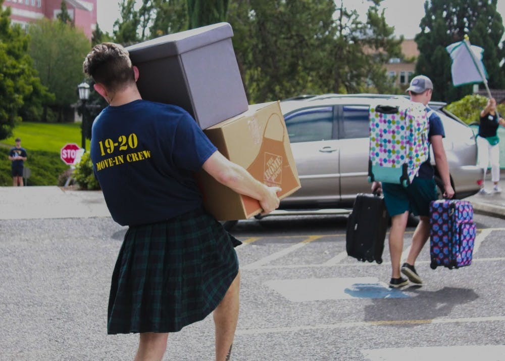 Members of Villa Maria Hall's 2019 Move-In Crew carry luggage and boxes to the dorms in August 2019. In an email brief sent to incoming freshmen and their parents on Friday, the University announced the possibility that the 2020 fall semester will have a late start due to COVID-19.