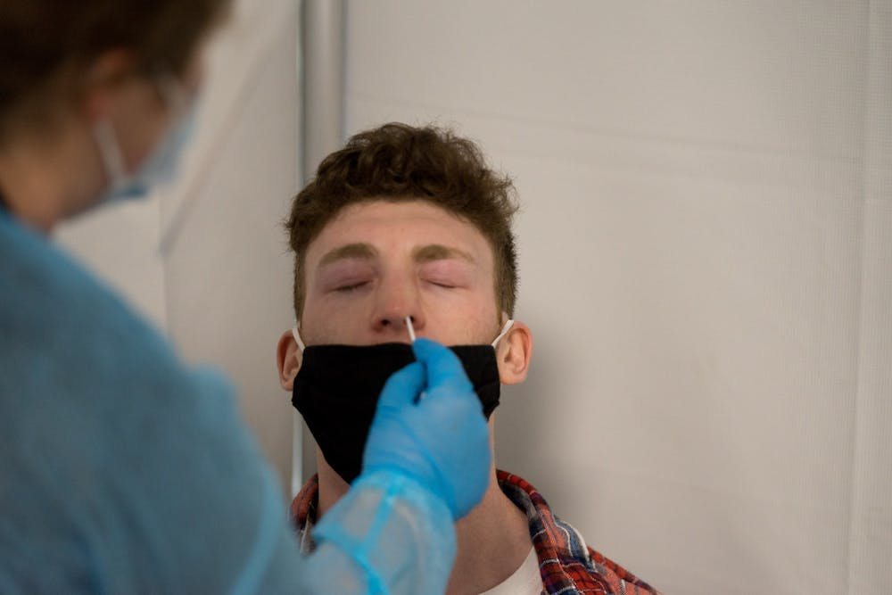 Bryce Crowder, freshman nursing major, gets his nose swabbed during a COVID-19 test. Students moving on campus were required to present a negative test result before being allowed in the buildings.