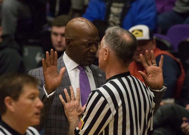 Coach Terry Porter challenges a referee about a call, one of several tense episodes during the game against St. Mary's