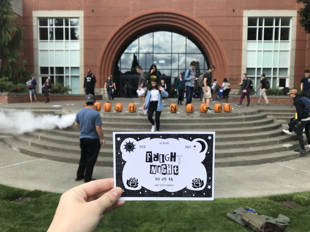 "Campus Program Board announced the fall dance theme by spelling out ""Fright Night"" on pumpkins outside of Franz Hall, accompanied by a smoke machine and spooky music."