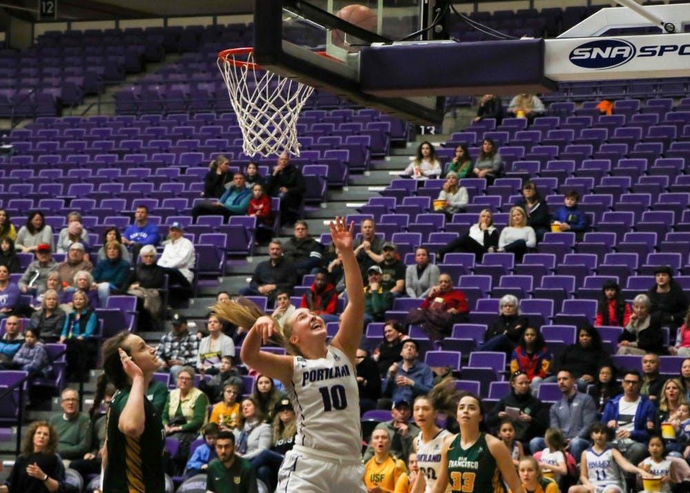 Freshman Haylee Andrews looks up watching her shot.