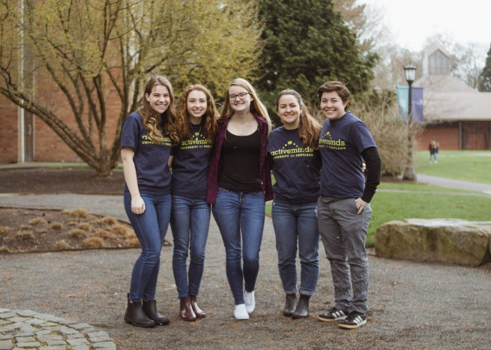 Community Engagement Editor Natalie Nygren poses with four of the five Active Minds officers. From Left to Right: Ryan Martin, Rachel Mehlman, Natalie Nygren, Peyton Hockett, Amy Moore.