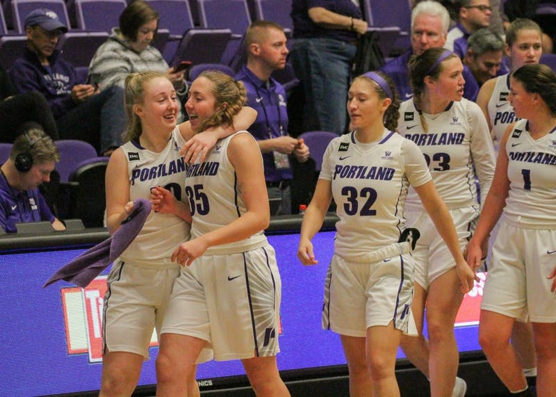 The Pilots celebrate their win over Puget Sound. The women's team won 88-45.