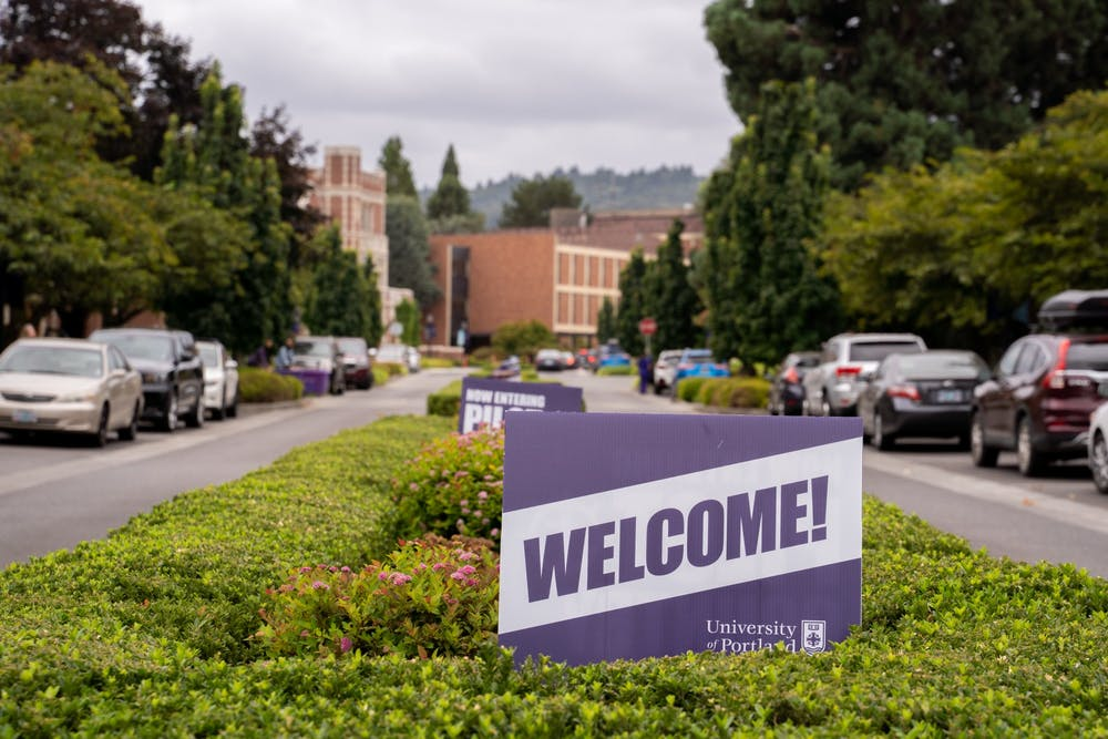 """A University of Portland """"welcome"""" sign at the main entrance to the campus."""