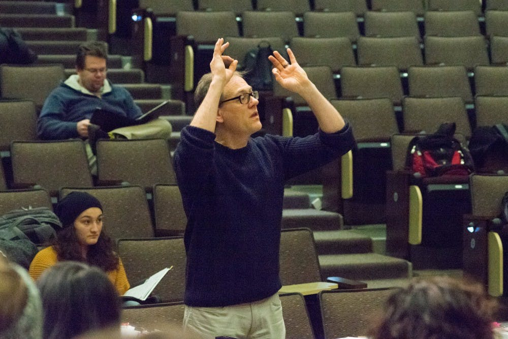 De Lyser conducts the University Singers as they rehearse songs from Hamilton.
