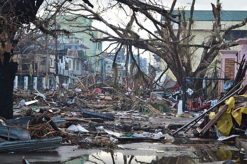 Debris line the streets of the city of Tacloban in the Philippines following the storm. Photo courtesy of Wikimedia Commons.