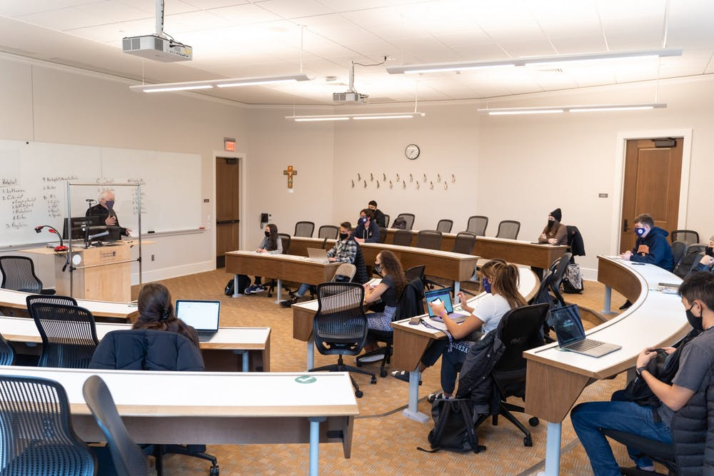 Fr. Art Wheeler was one of many volunteers to teach an in-person class this semester. Students are masked and socially distanced in the classroom.