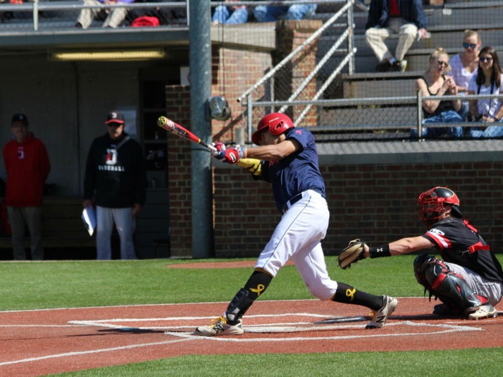 Sophomore Justin Cook hits during a 3-0 loss against Davidson.