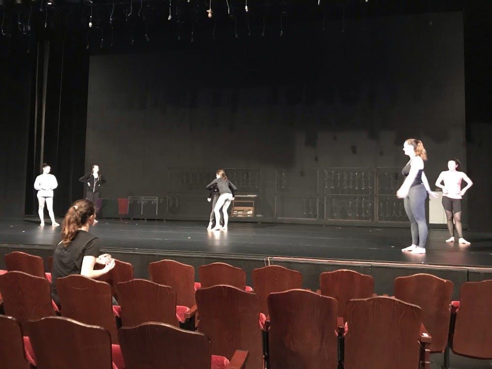 Senior Lauren Lambert (lower left) running rehearsals for her piece as a student choreographer.