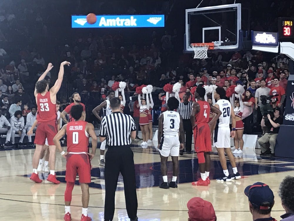 Redshirt sophomore Grant Golden shoots a free throw during the Spiders' home opener game against Longwood in the Robins Center on Thursday, Nov. 9.