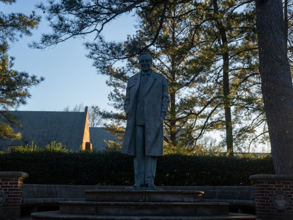 The statue of University benefactor E. Claiborne Robins stands in the academic quad.