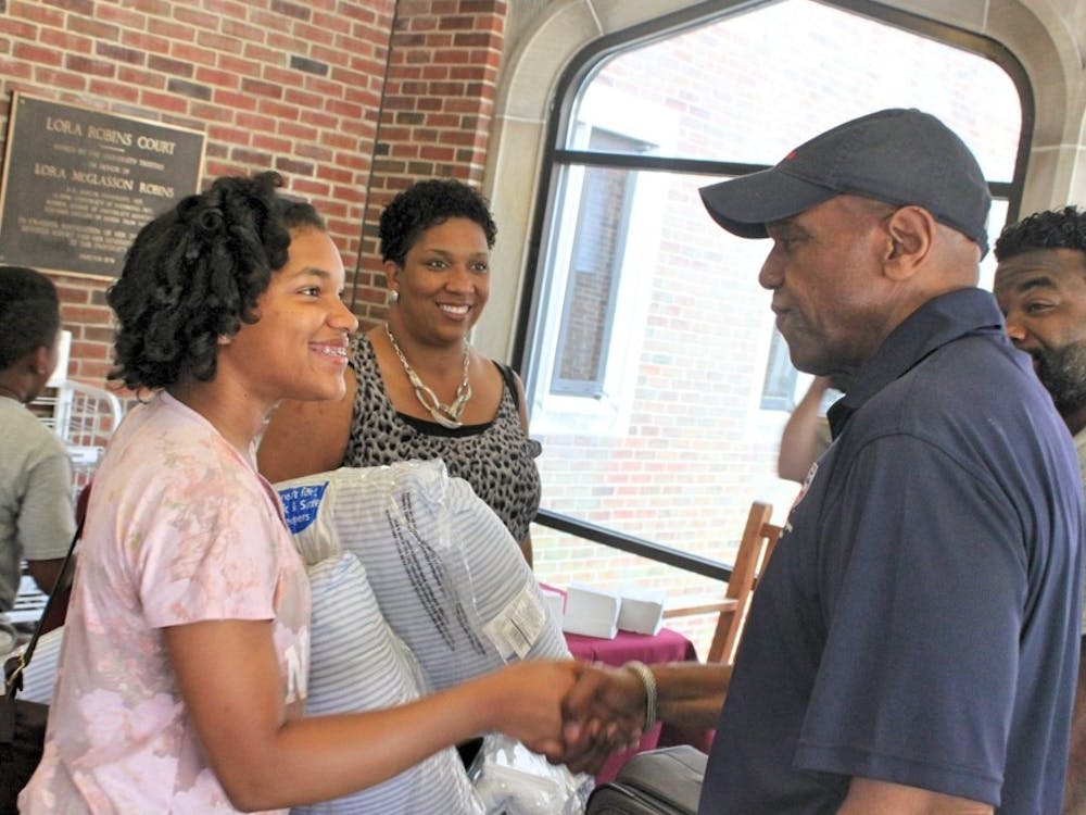 President Ronald Crutcher greets a student during freshman move-in day.
