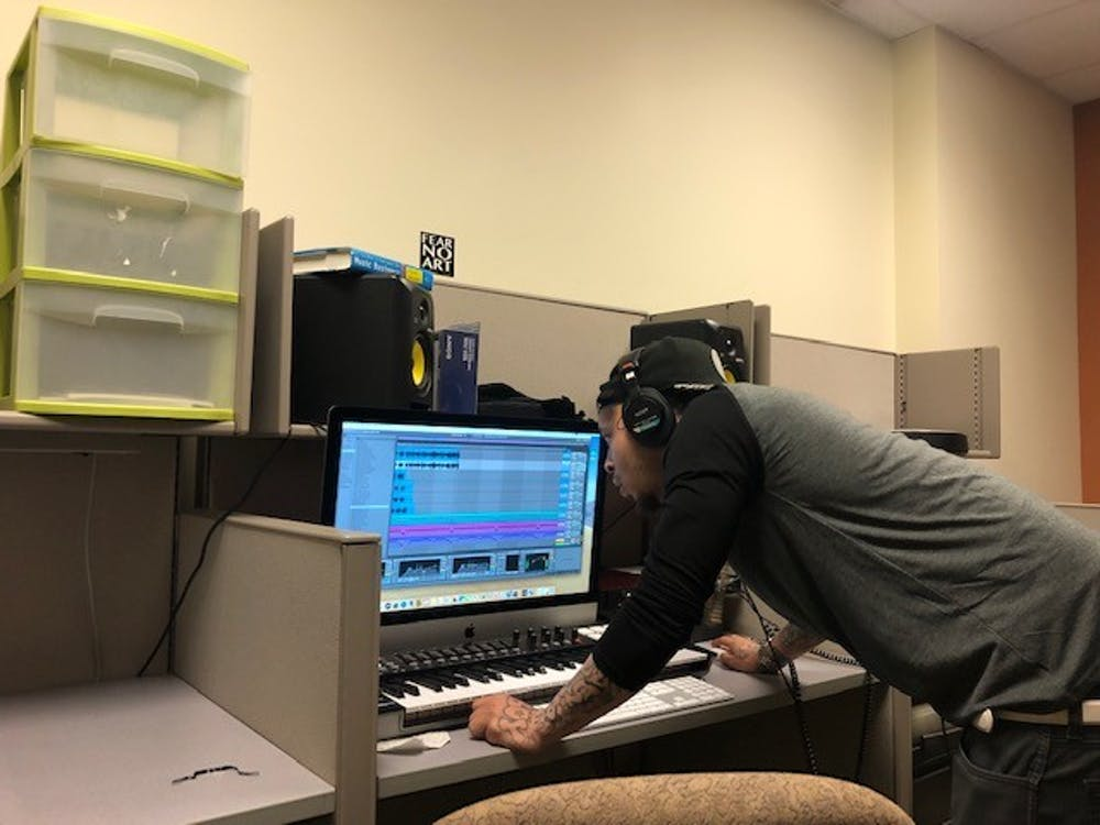 <p>Javier Rogers, a former Richmond city jail inmate, works on a song at the UR Downtown studio. Rogers started making the song while incarcerated.&nbsp;</p>