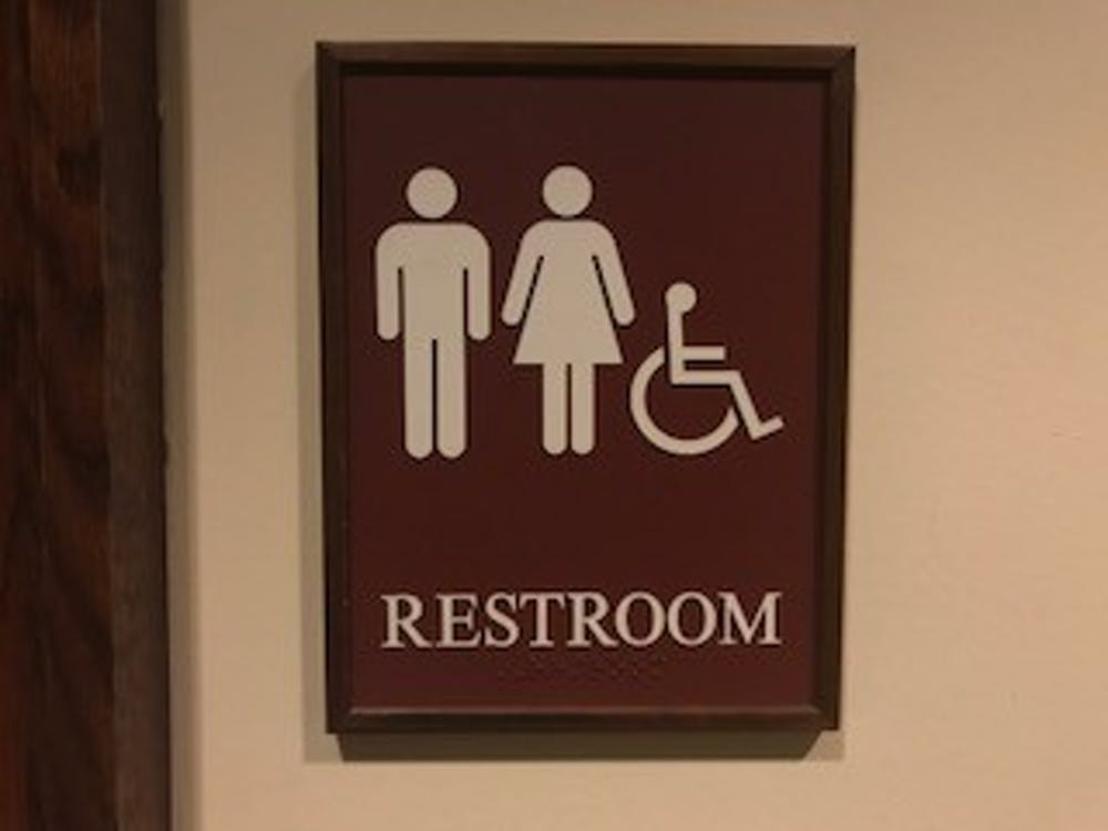 "One all-gender bathroom sign located on the first floor of the Modlin Center for the Arts. Other signs  on campus have the words ""All Gender Bathroom"" written on them."