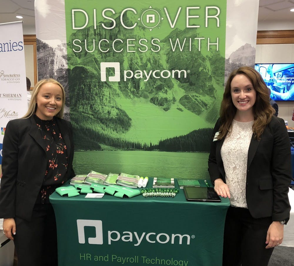 <p>From left, Paige Moynihan and Jill Roberts recruiting at the Spider Career Fair this fall for Paycom. <em>Photo courtesy of Paige Moynihan.</em></p>