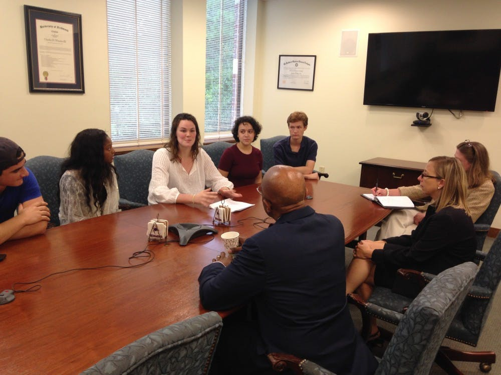 <p>President Crutcher sits down with members of SASAV, including Harrison, who is pictured addressing Crutcher.</p>