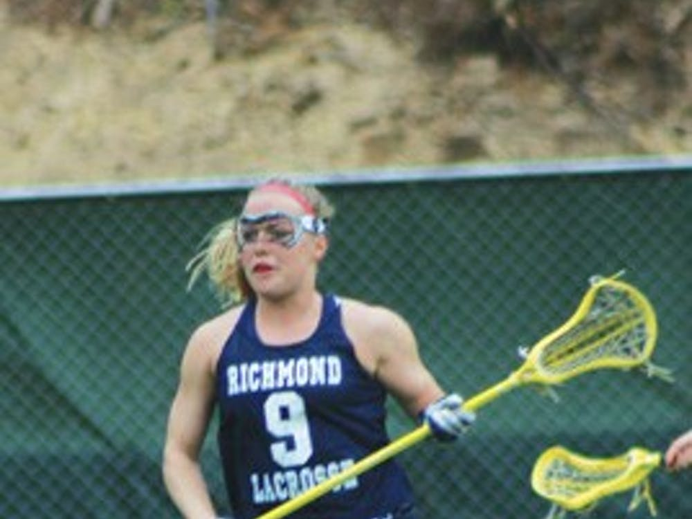 Lacrosse player Mandy Friend, '09, practices Friday afternoon at First Market stadium.