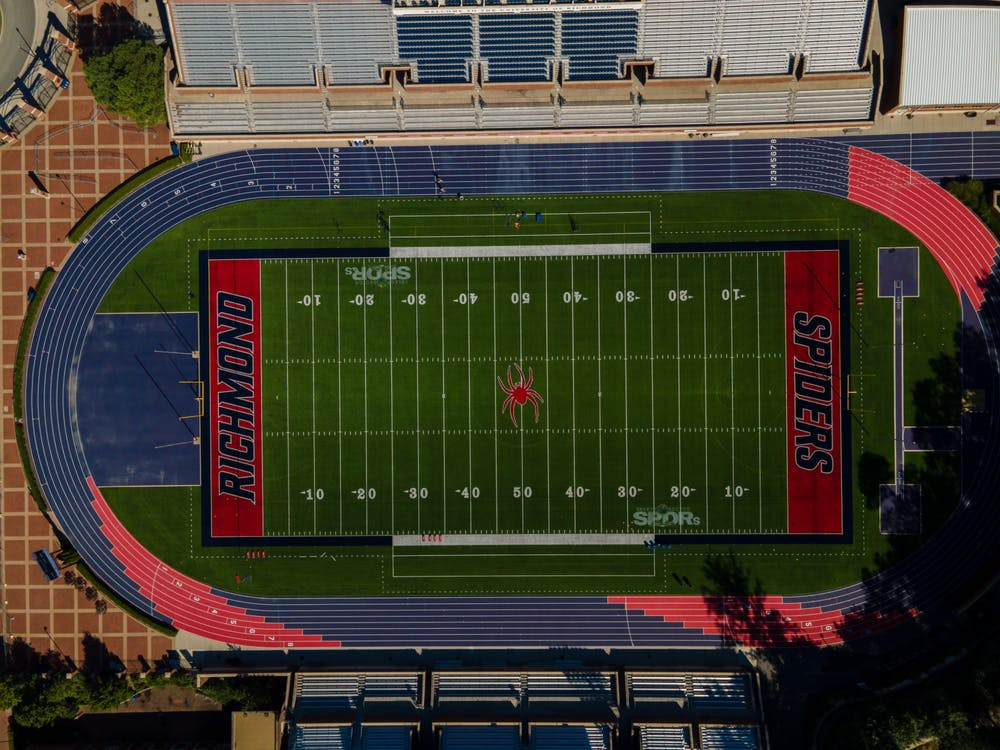 The grassy field of Robin's Stadium sporting the Spider's red and blue.