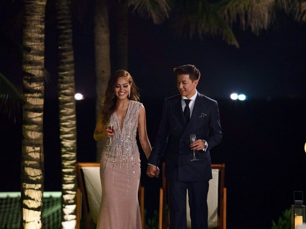 Senior Gwen Nguyen with the Bachelor Vietnam, Jean-Marc Trung Nguyen, during one of the reality TV show's cocktail parties. Photo courtesy of Gwen Nguyen.