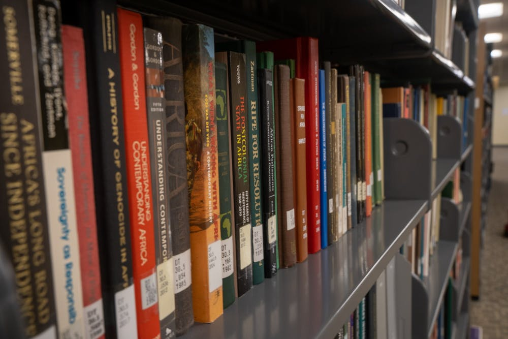 <p>Books on African studies in the stacks of Boatwright Memorial Library.</p>