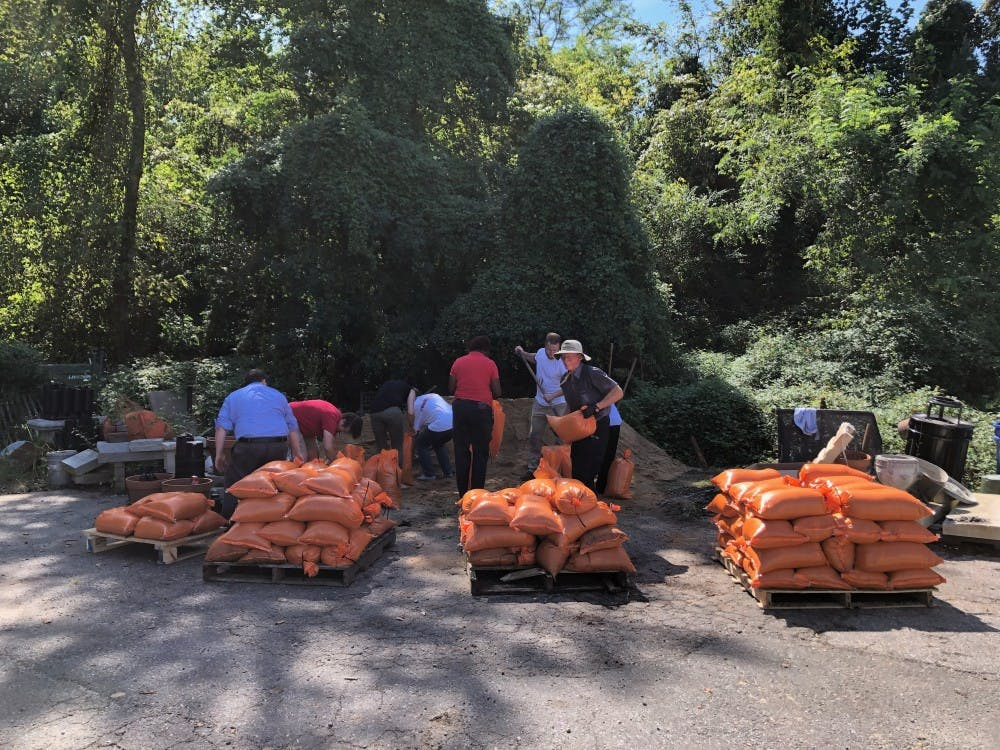 Facilities workers fill sandbags in anticipation of flooding on campus from Hurricane Florence.