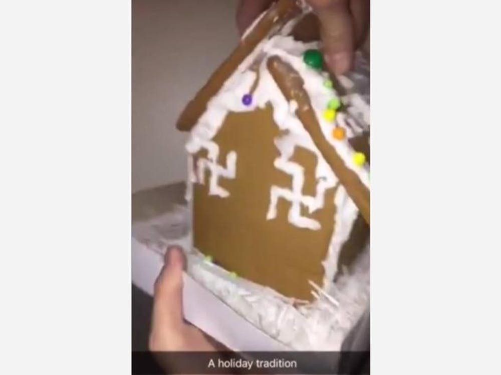 A screenshot of the video showing a gingerbread house decorated with swastikas. The video was geotagged to the University of Richmond on Monday night.