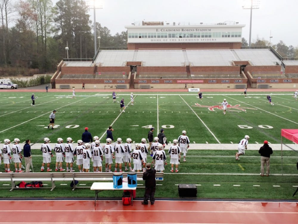 The University of Richmond men's lacrosse team battled past High Point in rainy conditions.