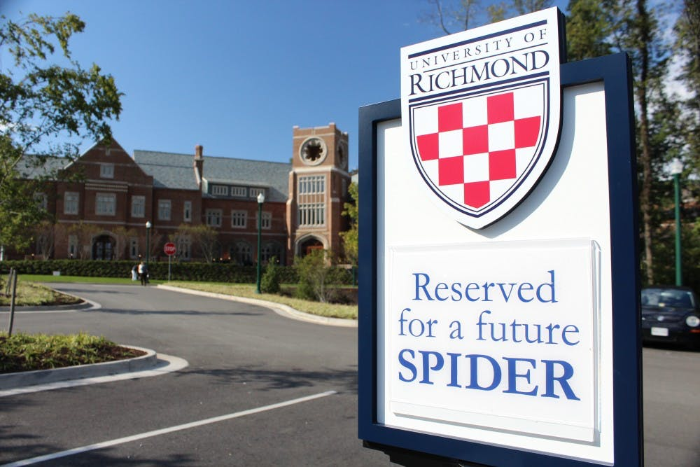 "<p>Signs reading ""Reserved for a future Spider,"" are placed in the parking lot across from the Queally Center for Admission and Career Services at the University of Richmond.</p>"