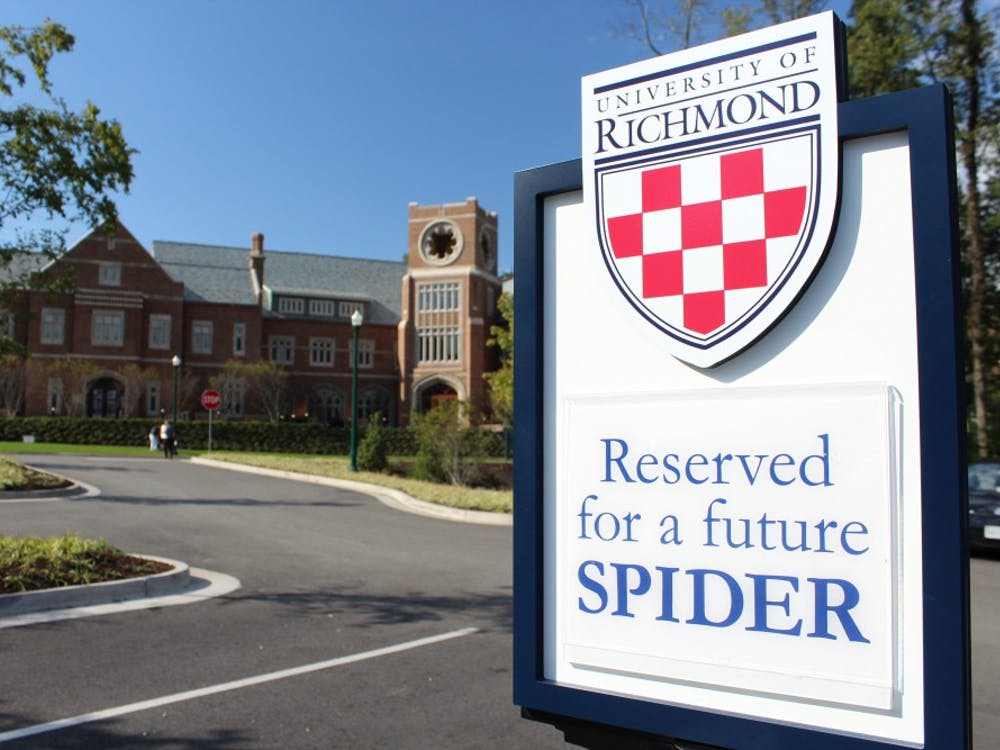 "Signs reading ""Reserved for a future Spider,"" are placed in the parking lot across from the Queally Center for Admission and Career Services at the University of Richmond."