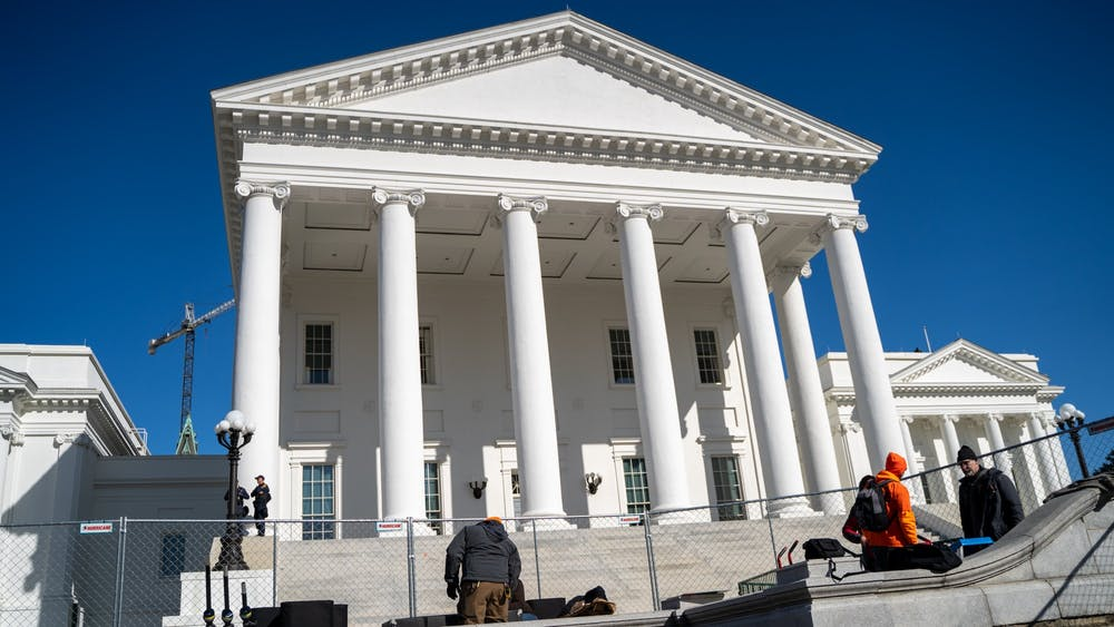 <p>The Virginia State Capitol fenced off on Lobby Day 2020.</p>