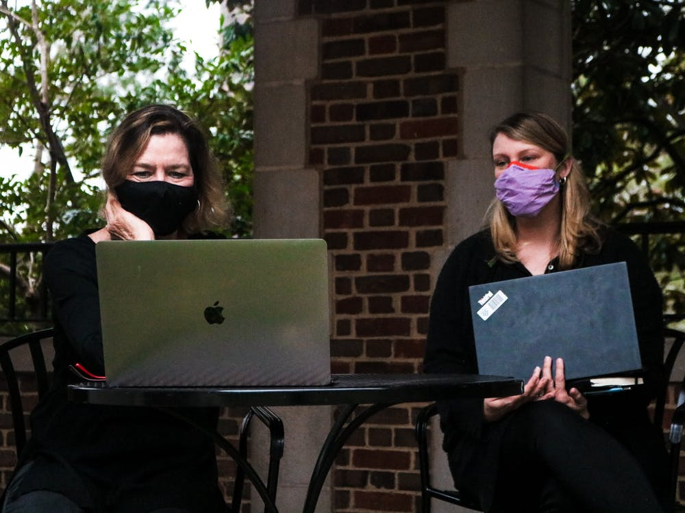 Two members of the community wearing black while watching the teach-in protest.