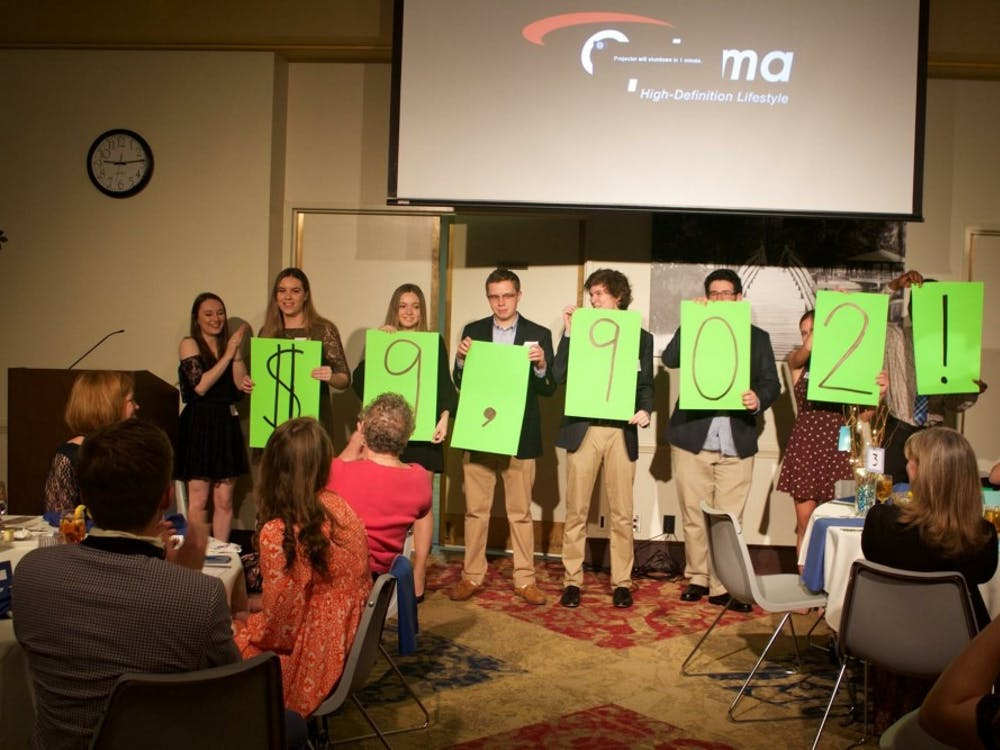 Student volunteers for Make the Magic reveal how much money was raised during the event.