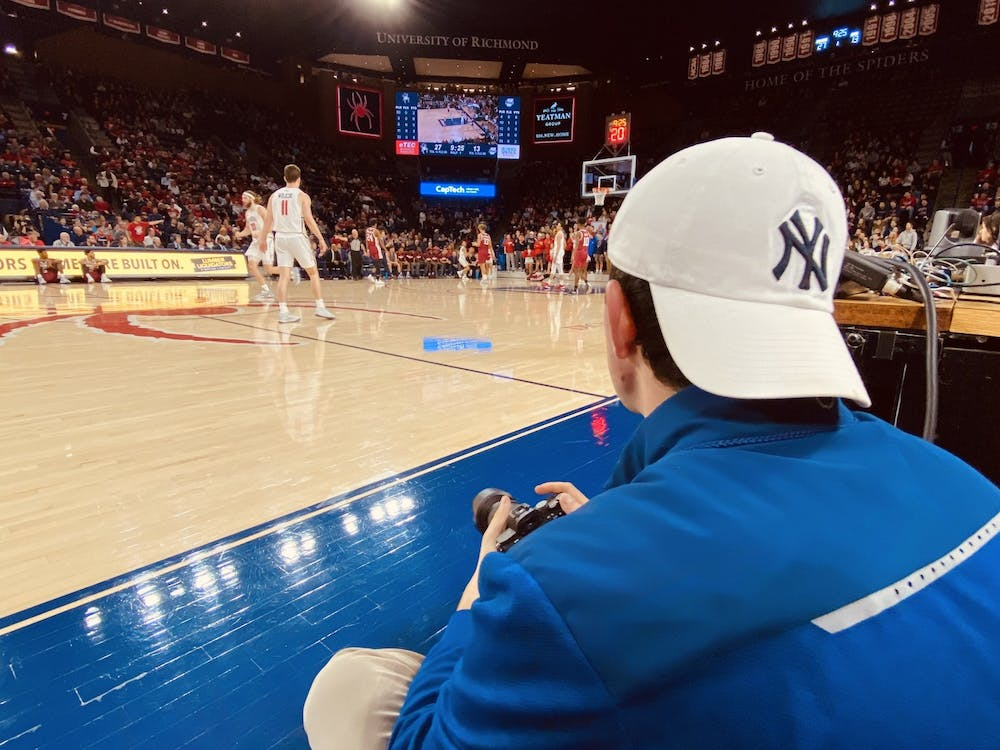 Kyle Gardner sitting courtside in the University of Richmond Robins Center during the Feb. 29 game against University of Massachusetts Amherst.