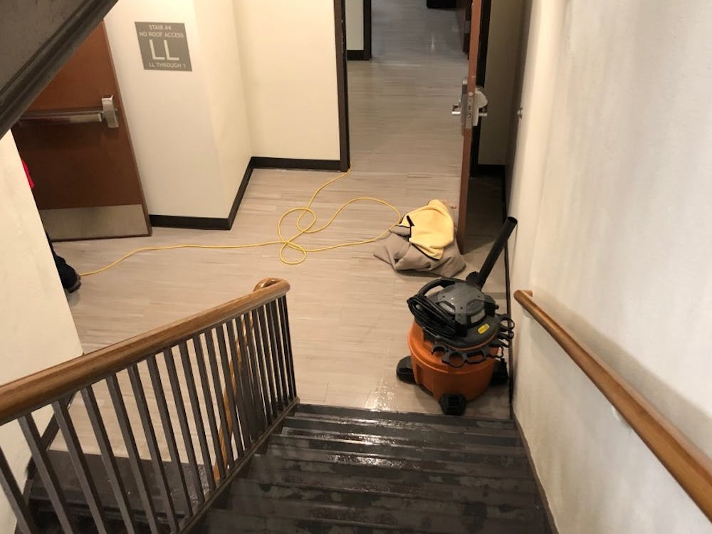 A water vacuum sits outside of the flooded room in Jeter Hall.