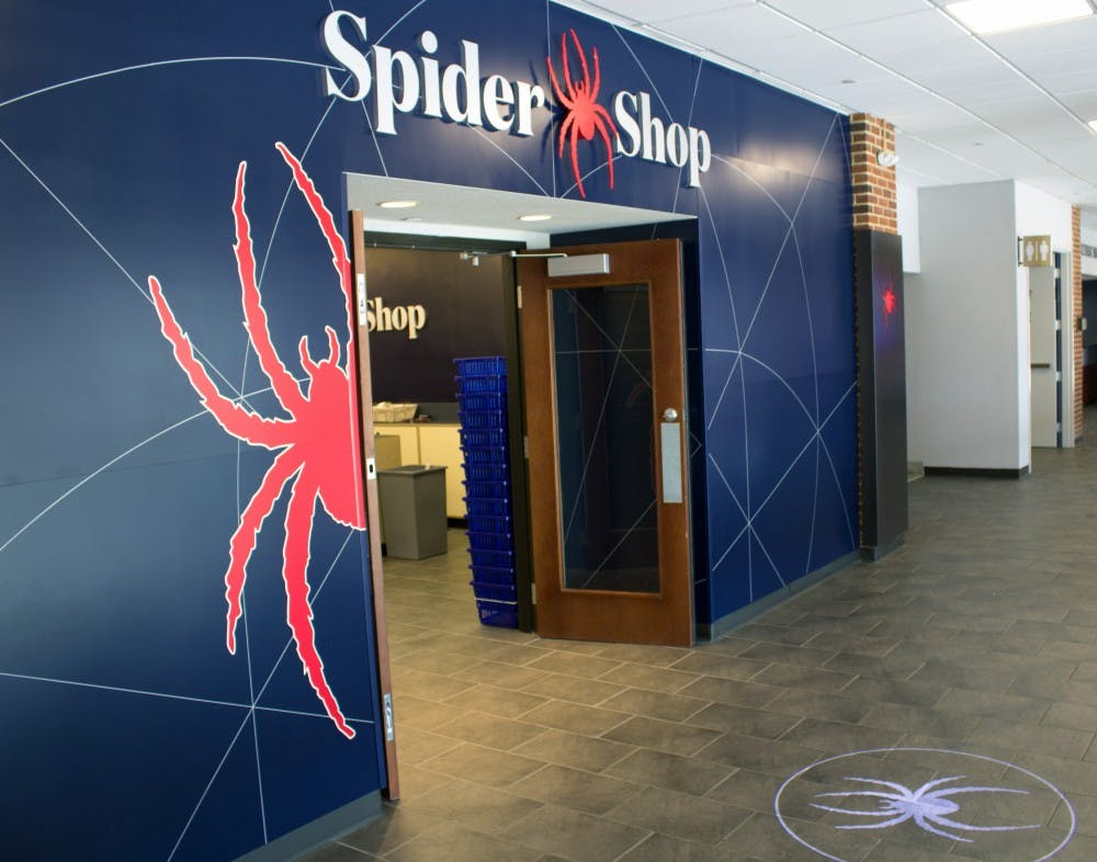 <p>The entrance to the SpiderShop, located in Tyler Haynes Commons, features a projected spider image on the ground.&nbsp;</p>